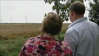 Jane and Julian Davis with windfarm in the distance