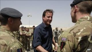Prime Minister David Cameron talks with British troops during a visit at Camp Bastion on 4 July