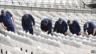 Police on a search exercise at the Olympic Stadium