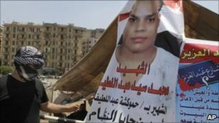 A poster showing Mohammed Sayyed Abdelatif, killed in the January/February uprising, at Tahrir Square in Cairo, Egypt - 3 July 2011