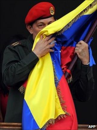 Hugo Chavez kisses Venezuelan flag on palace balcony - 4 July