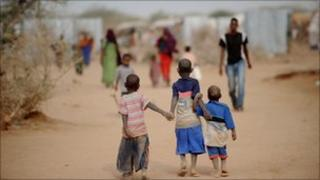Children walk down a dusty street in Dadaab refugee camp in Kenya on July 4, 2011.