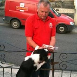 Wayne Davies with one of the dogs he meets on his rounds