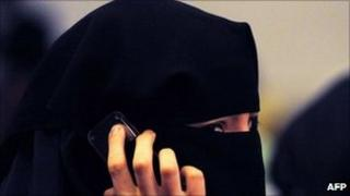 A woman wearing a burka talks on a mobile phone in Sydney. Photo: July 2011