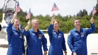 Atlantis shuttle crew waving American flags