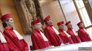 Judges arrive for a trial on euro bail-out at the German Constitutional Court in Karlsruhe, 5 July 11