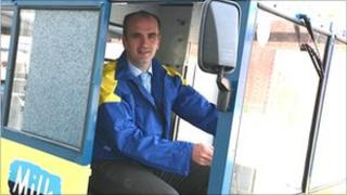 Graham Smith in a Kirby & West milkfloat