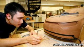 A student works on a car design project