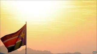 A South Sudanese flag flutters at sunset in January 2011