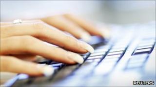 A woman uses a computer keyboard (file photo)