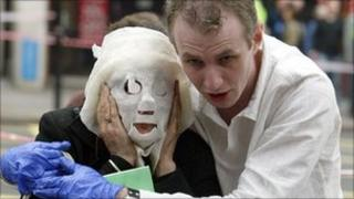 Paul Dadge helps Davinia Turrell (married name now Davinia Douglass) who is wearing a protective gauze mask, following an explosion at Edgware Road Tube Station on 7/7.