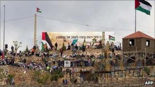 Palestinian protesters gather on the border between Lebanon and Israel, 15 May 2011