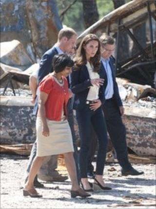 Prince William, Duke of Cambridge and Catherine, Duchess of Cambridge visiting a part of town devastated by a fire