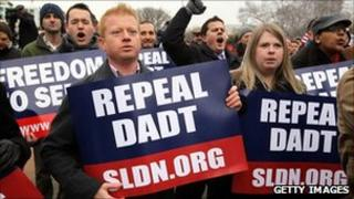 """Protesters holding signs that call for the repeal of """"don't ask, don't tell"""""""