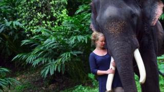 Laura Puukko with an elephant in Kerala