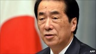 Japanese Prime Minister Naoto Kan addresses press representatives at his official residence in Tokyo on June 27, 2011