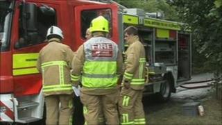 Firefighters at scene of barn fire on Friday, 8 July