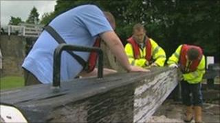 Volunteers painting a lock on the Leeds Liverpool canal near Bingley