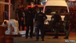 Police and forensic officers at scene of shootings in Monterrey, Mexico - 8 July 2011