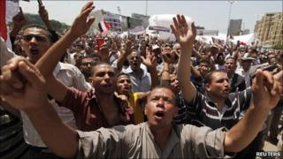 Egyptian protesters chant anti-government slogans in Tahrir square in Cairo, 9 July, 2011