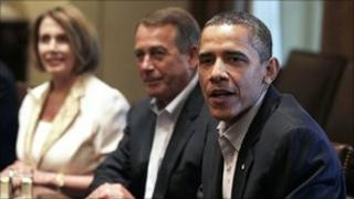 President Barack Obama, right, House Democratic Leader Nancy Pelosi, left, and House Speaker John Boehner, centre, meet with Congressional leadership in the Cabinet Room of the White House on 10 July