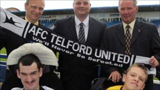 Neil Nash (chairman), Lee Carter (chairman, AFC Telford United), Councillor Arnold England (Telford and Wrekin Council) Simon Jordan and Jack Smith (players)