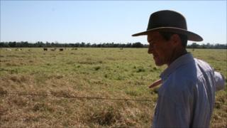 Heinrich Dueck surveys his land