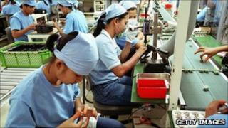 workers assemble micro motor fans