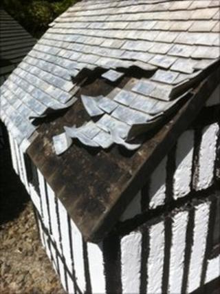 Damaged roof of Tudor-style manor house