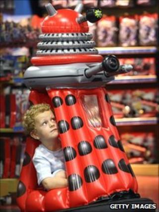 Boy tries out motorised dalek at Hamleys in London