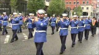 The main parade in Belfast began at about 1030 BST
