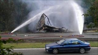 Water being sprayed on the burning lorry