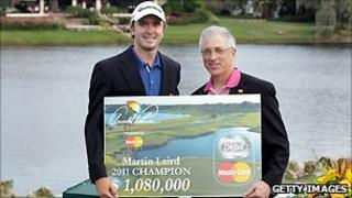 Martin Laird of Scotland holds his Mastercard-backed prize at the 2011 Arnold Palmer Invitational Golf tournament