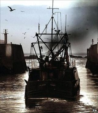 Fishing boat leaving a harbour (Image: PA)