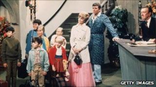 The Brady Bunch cast in a still from the television show