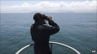 A Navy sailor looking for the seven men lost at sea