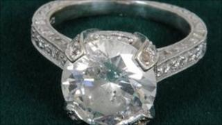 South Yorkshire Crimewatch appeal. White gold with diamond encrusted shoulders and a centre solitaire 5-6 ct diamond.