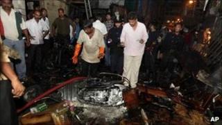 Police inspect the site of the Zaveri Bazaar bomb - 13 July 2011