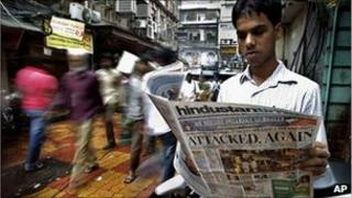A man reads a newspaper at Zaveri Bazaar a day after the blasts in Mumbai on 14 July 2011