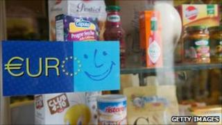 An old sign welcoming the Euro is seen on the window of a food shop near Accademia, Italy