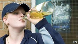 Teenage girl drinking