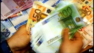 Cashier counting euro notes