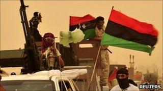 Libyan rebels west of Ajdabiya