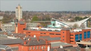 Wrexham's high-rise police station and the sloped-roof of the Waterworld swimming baths