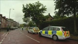 Police near the scene in Northenden