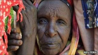 "A newly-arrived refugee waits for registration outside at Dadaab camp, near Kenya""s border with Somalia, July 16, 2011"