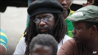 Munyaradzi Gwisai, (C), who goes on trial on 18 July for treason, photographed at a court hearing in February