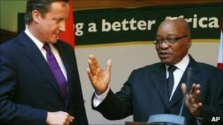 British Prime Minister David Cameron, left, holds a press conference with South African President Jacob Zuma