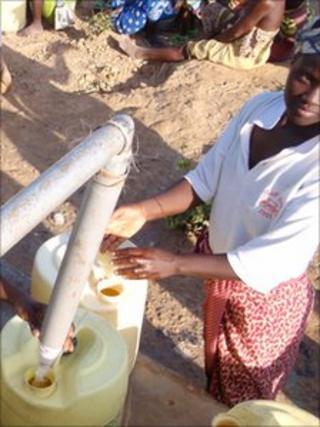 Woman getting water in Kenya