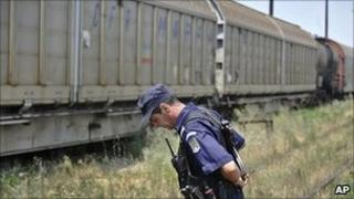 Police guard the freight train. 18 July 2011